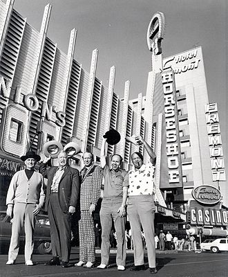 Johnny Moss - A group of players outside of Binion's Horseshoe in 1974. The players pictured are (from left to right) Johnny Moss, Chill Wills, Amarillo Slim, Jack Binion, and Puggy Pearson.