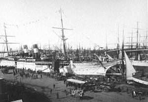 Foreign trade of Argentina - Port call on Buenos Aires' southside wharf (La Boca), circa 1888. Financed mostly with British capital, massive dock works touched off a foreign trade boom that reshaped the previously isolated Argentine economy.
