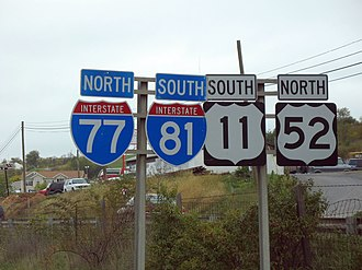 Highway shield - The shields for Interstate highways (left) and U.S. routes (right) can be seen on this set of reassurance markers in Southwest Virginia indicating two sets of wrong-way concurrencies
