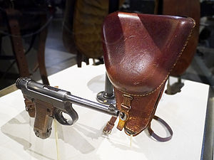 Nambu pistol - Nambu Type 14, Series 1, original pistol and holster, exhibited in the Texas Military Forces Museum.