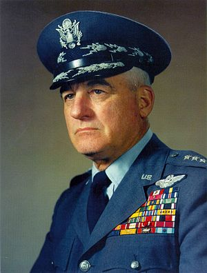 Scrambled egg (uniform) - United States Air Force General Nathan Farragut Twining wearing his dress hat with silver cloud and lightning bolt embellishments