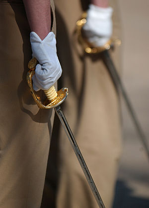 Ceremonial weapon - United States Naval Academy Midshipmen practice carrying ceremonial swords