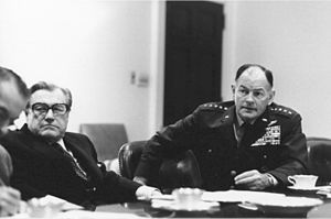 George Scratchley Brown - Brown and Vice President Nelson Rockefeller listen to a briefing on the evacuation of Saigon, 28 April 1975