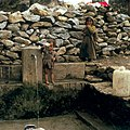 Nepal. Sherpa children at a water pipe, 1986.jpg