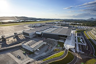 Bergen Airport, Flesland - Image: New Bergen Airport Flesland with old terminal in the background