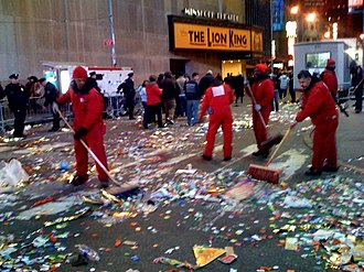 Times Square Ball - Workers clearing trash from Times Square following the festivities.