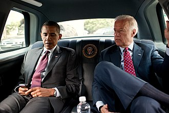 Presidential state car (United States) - President Barack Obama and Vice President Joe Biden riding in the presidential state car