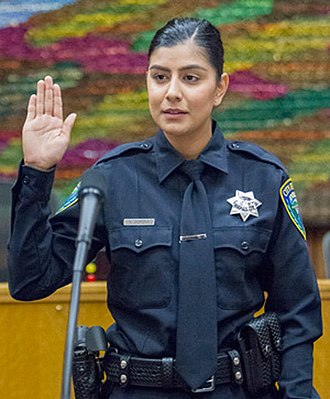 Oath - A new police officer in the US being sworn in, 2018