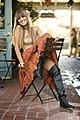 Olivia Evita seated on a chair.jpg