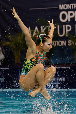 Synchronised swimming - A member of the Japanese team is thrown up in the air during the team's free routine at the 2013 French Open.