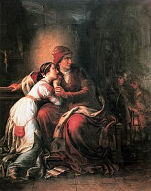 Middle-aged woman holding a young woman in her arms