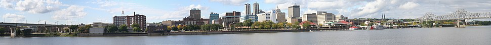 Panorama of downtown Peoria, viewed from across the Illinois River in East Peoria. In the middle are the Twin Towers, the Former Caterpillar World Headquarters Building, and the Associated Bank Building