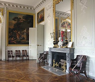 Petit Trianon - The salle à manger (dining room): finely carved boiseries are without gilding, simply painted to complement the bleu Turquin chimneypiece