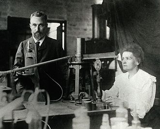 Radioactive decay - Pierre and Marie Curie in their Paris laboratory, before 1907