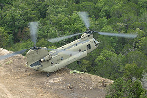 Boeing CH-47 Chinook - A CH-47F practicing the pinnacle maneuver whereby soldiers are deposited without the helicopter landing