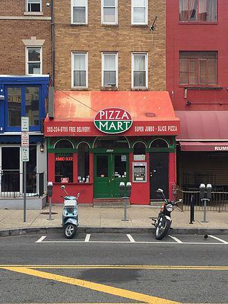 "Jumbo slice - Pizza Mart in Adams Morgan, home of the ""real original jumbo slice"""