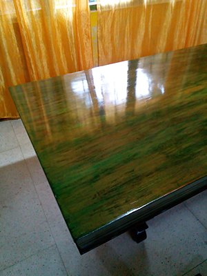 Varnish - A table green wood-stained and varnished with three layers of polyurethane varnish