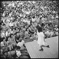 Poston, Arizona. A young evacuee of Japanese ancestry entertains her fellow evacuees with a demonst . . . - NARA - 538562.jpg