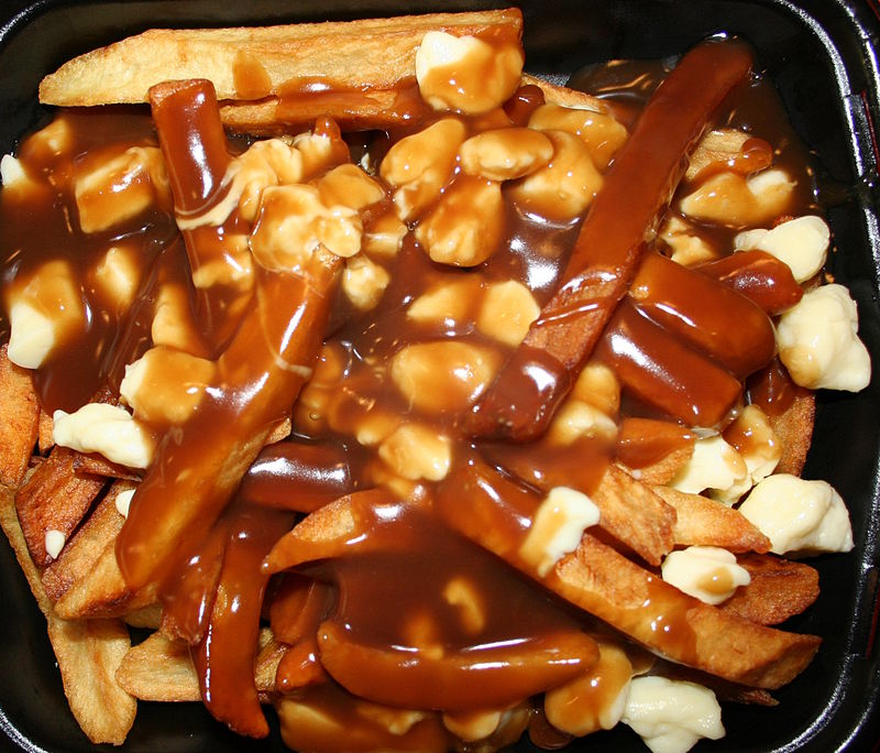 Poutine with a thicker beef gravy, plate originated from Quebec