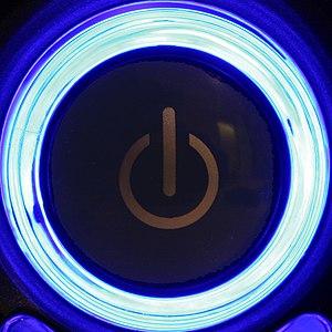 Galego: Un botón para acender un aparato elect...