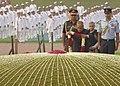Pranab Mukherjee garlanding at the Samadhi of the former Prime Minister, Pandit Jawaharlal Nehru on his 123rd birth anniversary, at Shantivan, in Delhi. The Chief Minister of Delhi, Smt. Sheila Dikshit is also seen.jpg