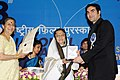 Pratibha Devisingh Patil presenting the Swarna Kamal Award to Shri Arbaaz Khan for the Best Popular Film Providing Wholesome Entertainment (Dabangg), at the 58th National Film Awards function.jpg