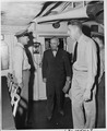 President Harry S. Truman is accompanied by Commander C. L. Freeman as they tour the U. S. S. Augusta and inspect the... - NARA - 198734.tif