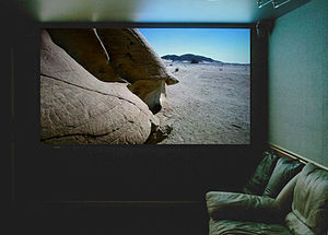 A large projection screen in a media room.