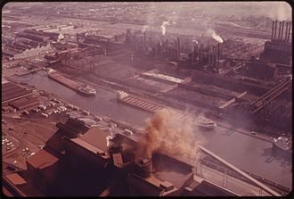Ford River Rouge Complex - Lake freighters maneuver in the canal to unload ore at the plant, 1973