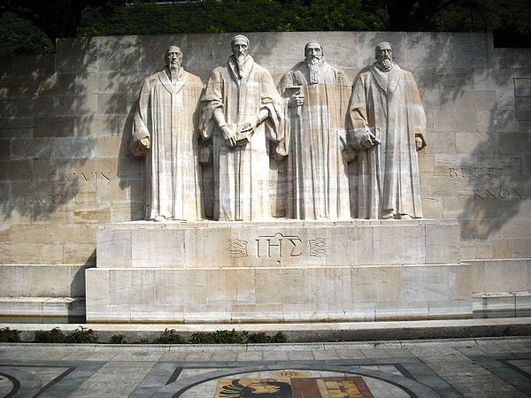 Statues of William Farel, John Calvin, Theodore Beza, and John Knox at the centre of the International Monument to the Reformation in Geneva, Switzerland. They were among the most influential theologians that helped develop the Reformed tradition. ReformationWallGeneva.JPG