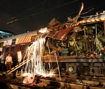 Railway workers cutting a damaged part of the bomb-damaged coaches Rescue efforts.jpg