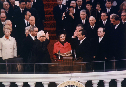 Nixon is sworn in as the 37th President by Chief Justice Earl Warren on January 20, 1969, with the new First Lady, Pat, holding the family Bibles. Richard Nixon 1969 inauguration.png