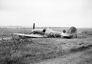 RAF Lympne - Royal Air Force 1939-1945. A Hawker Typhoon IB that has belly landed at Lympne after hitting a telegraph pole over France