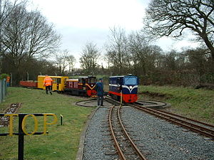 Ruislip Lido Railway - 'Graham Alexander' on the Ruislip Lido Station turntable with 'Lady of the Lakes' in the background with the maintenance train