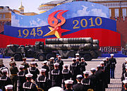 Members of Commander, U.S. Naval Forces Europe Band prepare to perform during the 2010 Victory Day Parade. Two S-400 SAMS are driving in front of the band.