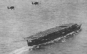 Japanese aircraft carrier Ryūjō - Ryūjō during the 1930s with a pair of Aichi D1A2 dive bombers overhead
