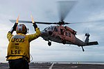 Sailor directs a MH-60S Seahawk helicopter during recertification of Green Bay's Flight Deck (27095241504).jpg