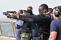 Sailors from Cameroon, Gabon and the Republic of Congo fire 9 mm pistols in small-arms qualifications training aboard the guided missile frigate USS Simpson (FFG 56) as part of Africa Partnership Station (APS) 120209-N-IZ292-416.jpg