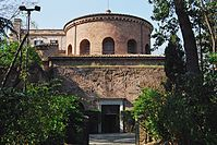 Exterior of the dome of Santa Costanza showing the windows in a cylindrical drum that hides the shape of the dome from view