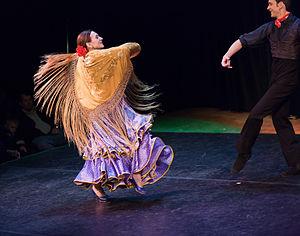 Flamenco dancing woman with a shawl. Internati...