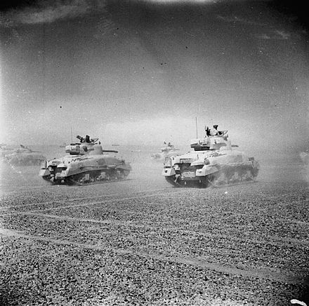 Sherman tanks of the Eighth Army move across the desert Sherman tanks of the Eighth Army move across the desert.jpg