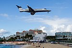 Smaller Jet on Final approach at Maho Beach St Martin (8462303650).jpg