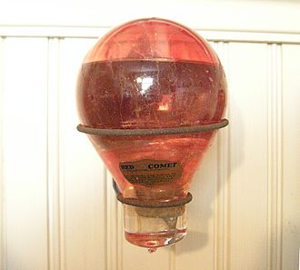 "Carbon tetrachloride - A Red Comet brand glass globe (""fire grenade"") containing carbon-tetrachloride"