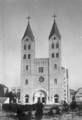 A black and white photograph of Saint Michael's Cathedral, from the front, with twin bell towers flanking the doorway