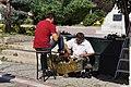Street shoeshiners (15235366971).jpg