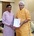 Sudarshan Bhagat handing over a memorandum to the Minister of State for Communications (IC) and Railways, Shri Manoj Sinha for bringing Gumla Parliamentary constituency on rail map of India, in New Delhi.JPG