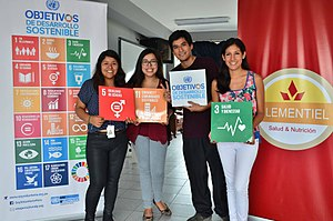 Sustainable Development Goals - Young people holding SDG banners in Lima, Peru.