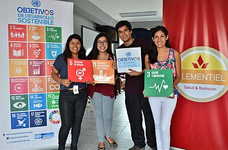 Sustainable Development Goals - Young people holding SDG banners in Lima, Peru