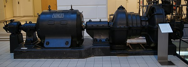 A small industrial steam turbine (right) directly linked to a generator (left). This turbine generator set of 1910 produced 250 kW of electrical power. - Steam turbine