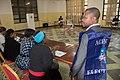 Temoins, observateurs, journalistes assis près d'un centre dans un bureau de vote de la CENI à Bukavu (44709877470).jpg